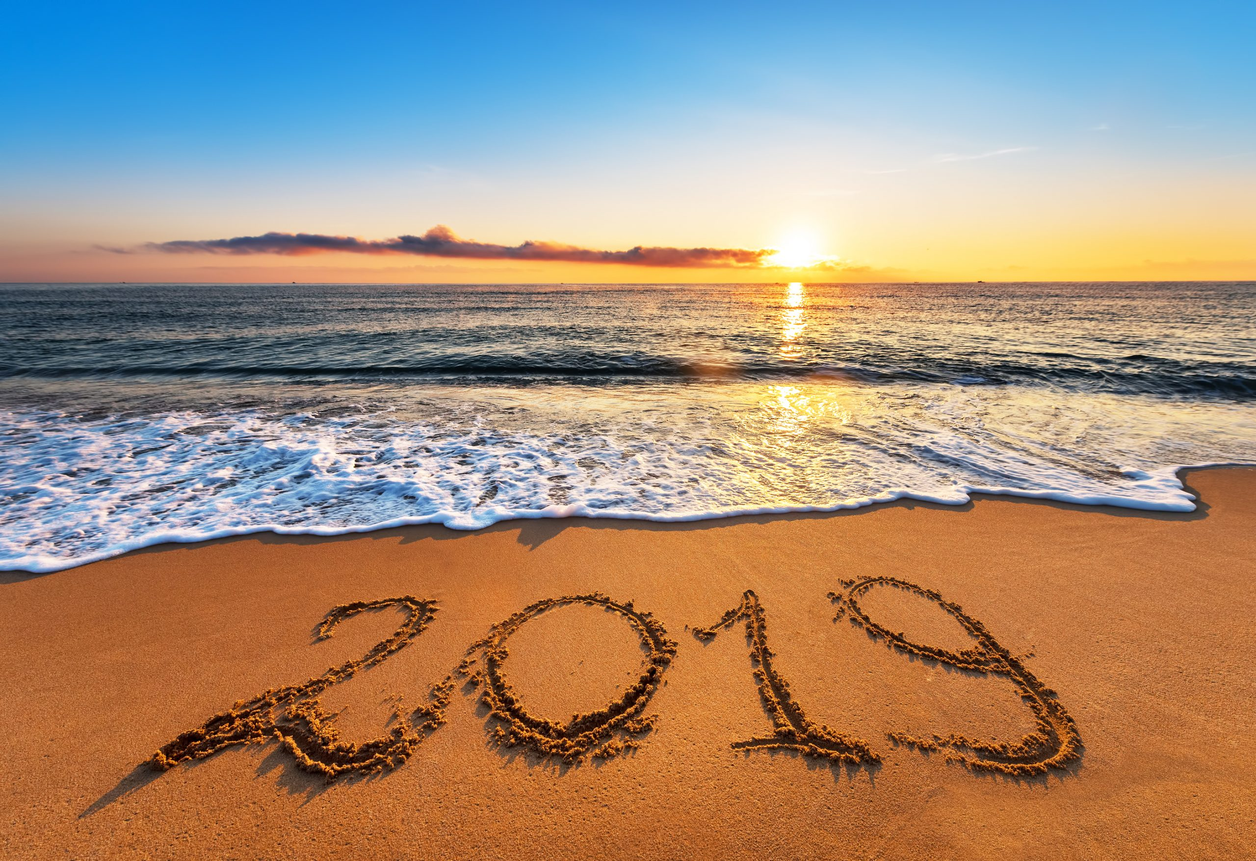 Number 2019 Written On Seashore Sand At Sunrise.Happy New Year